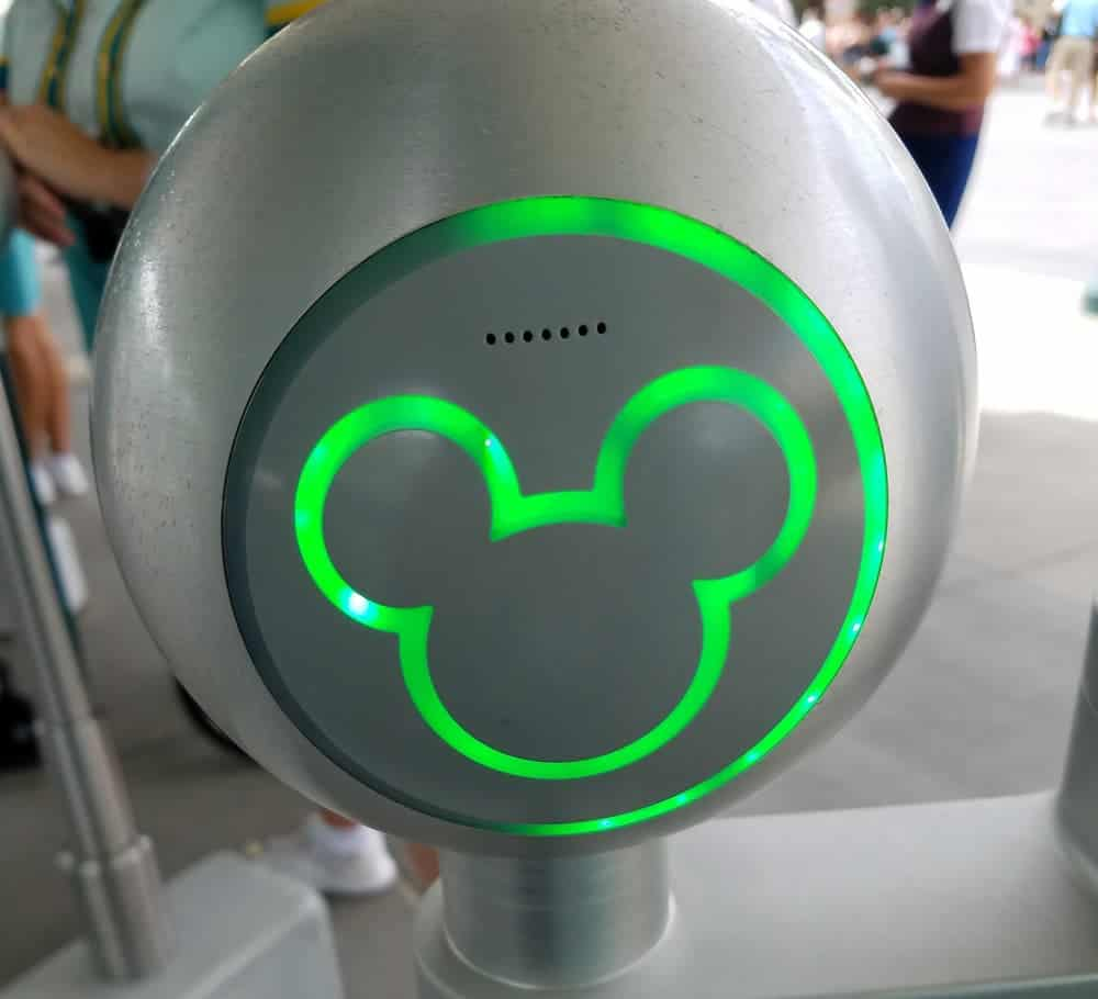 green mickey lit up from scanning the magic band