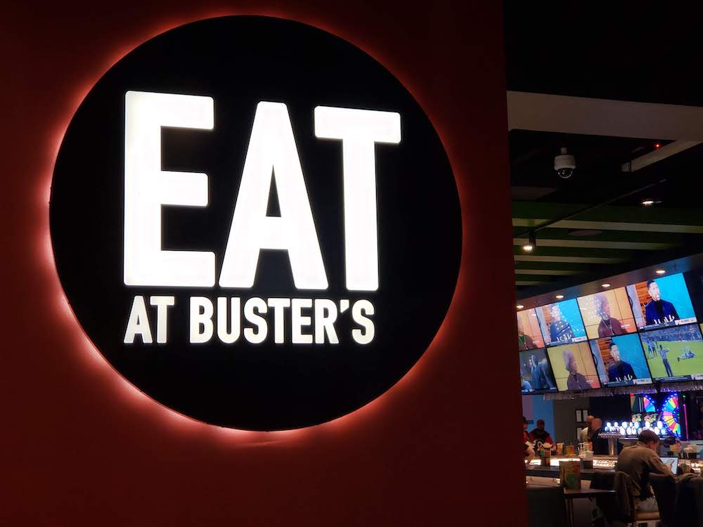 eat some delicious food at Dave and Buster's