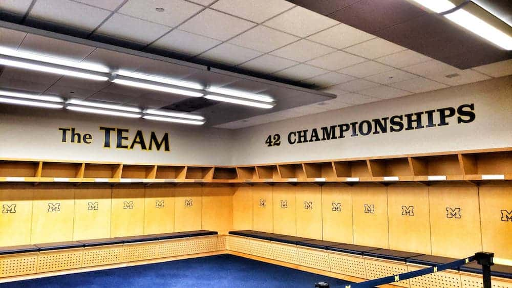 Inside the game day locker room at The Big House.