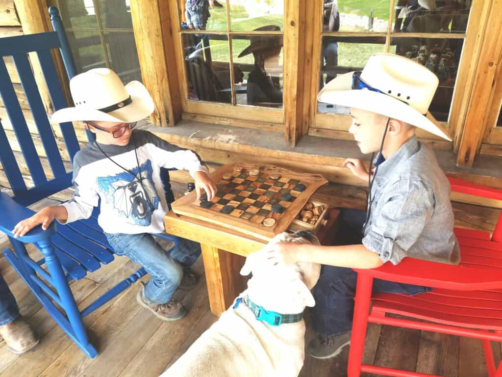Playing games on the front porch of Rawah Guest Ranch